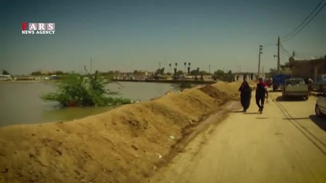 فیلم  استقامت غرورآفرین جوانان خوزستانی/ سیل را به گریه انداختیم